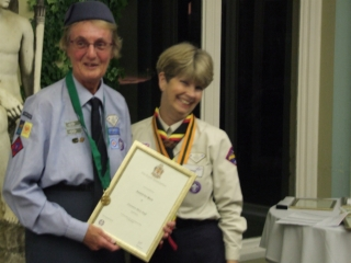 Veronica receiving her well deserved Medal of Merit